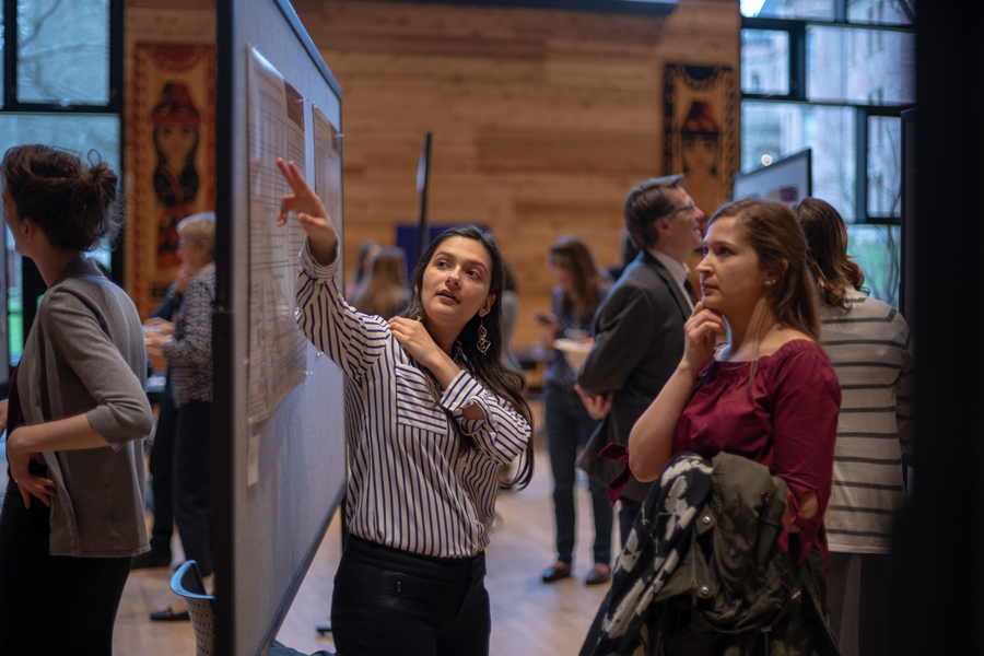 School of Public Health student presents research in poster session.